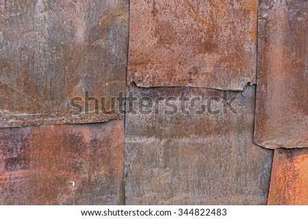Scratched and spotted rusty metal background. - stock photo