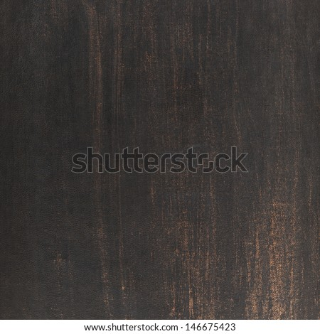 Scratched dark old leather texture as a background - stock photo