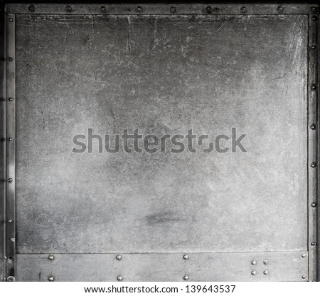 Scratched metallic background with rivets - stock photo