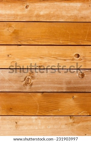 Scratched timber wall. Light wood texture background in sunlight. - stock photo