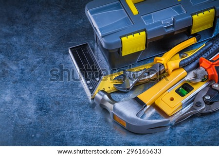 Scratched vintage metallic surface with closed toolkit and big toolset construction concept. - stock photo