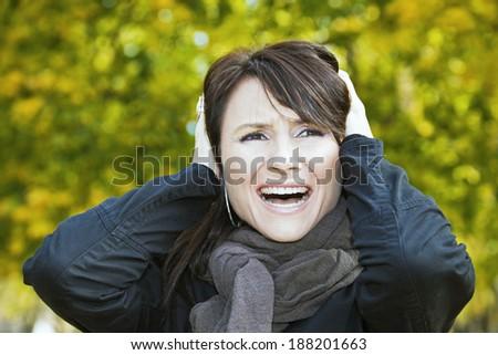 Scream! - girl in colorful park. - stock photo