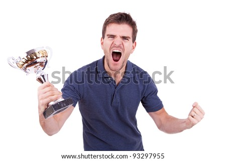 scream of victory of a young casual man winning a trophy, on white background - stock photo