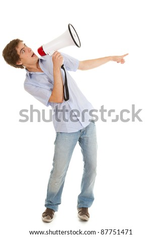 screamimg young man holding megaphone and pointing, white background - stock photo