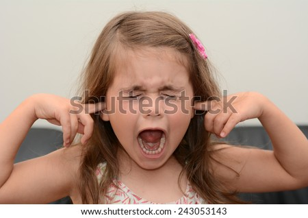 Screaming child (girl age 05) face. concept photo of stress and anxiety. - stock photo