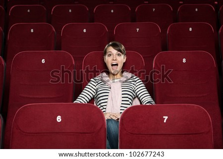 Screaming girl at the cinema - stock photo