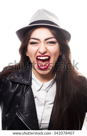 Screaming girl wearing in rock style - stock photo