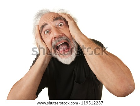 Screaming man covering his ears over white background - stock photo