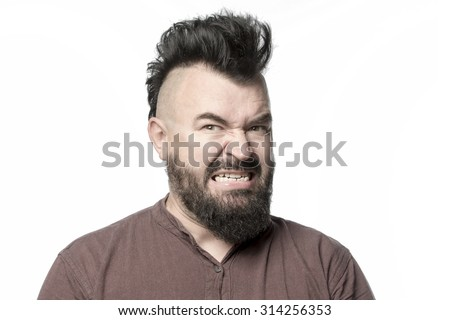 Screaming man with a mohawk and beard, isolated - stock photo