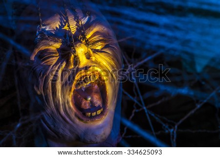 Screaming scary face with spider webs. - stock photo