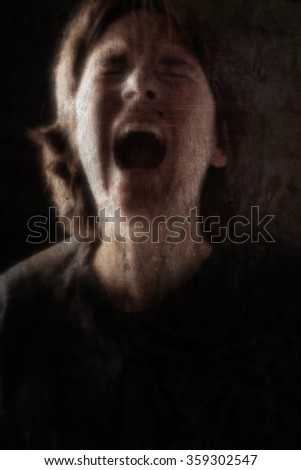 Screaming woman grunge blurred image - stock photo