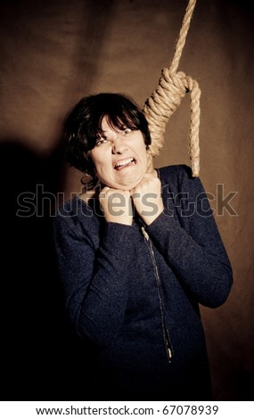 Screaming woman in medieval suit with rope on her neck - stock photo