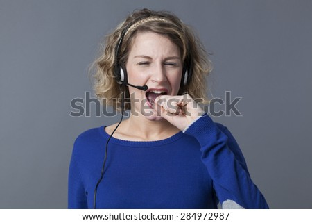 screaming young female assistant getting mad talking with her headset - stock photo