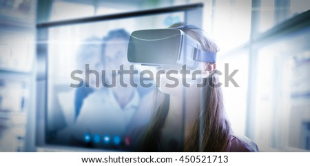 Screen of a video call against graphic designer using virtual reality headset in office - stock photo