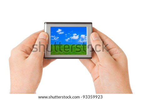 Screen with landscape in hands isolated on white background - stock photo