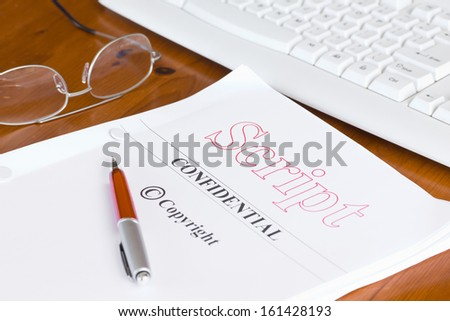 Script Screenplay on Desk with Pen and Spectacles  - stock photo