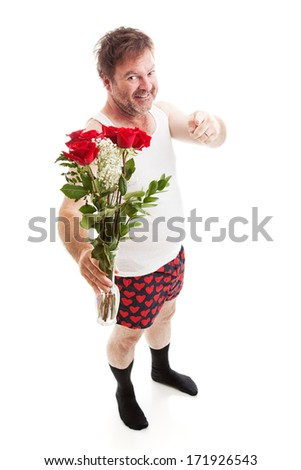 Scruffy looking guy in his underwear with too much confidence holding a vase of red roses and pointing at you. Full body isolated on white.      - stock photo