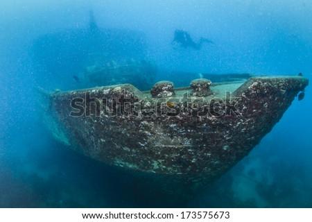 Scuba Diver alone at the Atlantic Princes Shipwreck in Bayahibe, Dominican Republic in Caribbean Sea - stock photo