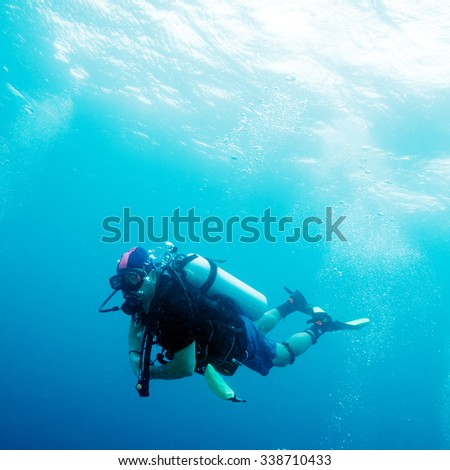 Scuba Diver in Ocean Blue - stock photo