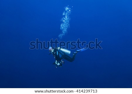 Scuba diver in tropical coral reef, Layang Layang - stock photo