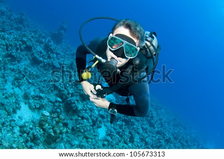 scuba diver on a dive in Bahamas - stock photo