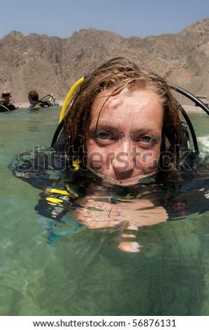 scuba diver on surface - stock photo