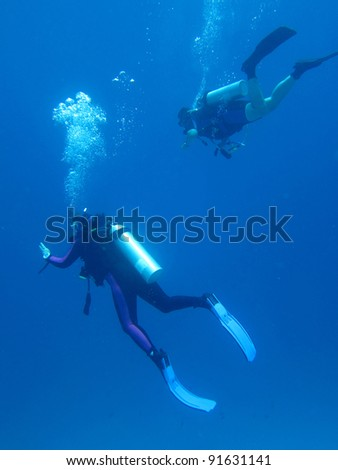 Scuba divers - stock photo