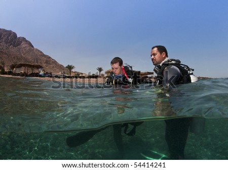 scuba divers before diver - stock photo