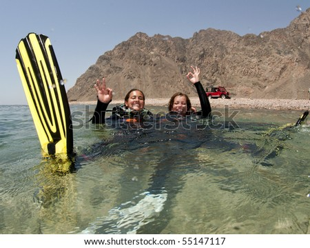 scuba divers on the surface - stock photo