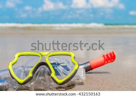 Scuba Diving Equipment On The White Sea Sand Beach - stock photo