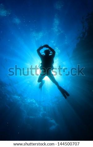 Scuba Diving in ocean - stock photo
