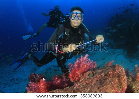 Scuba diving on underwater coral reef - stock photo
