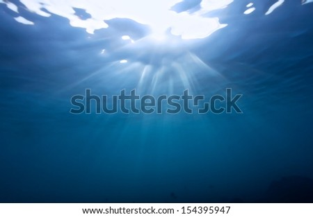 scuba diving shot in the shallow with bright sun ray - stock photo