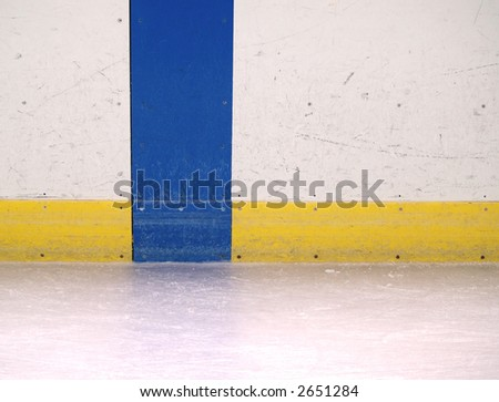 scuffed up boards in an ice skating rink - stock photo