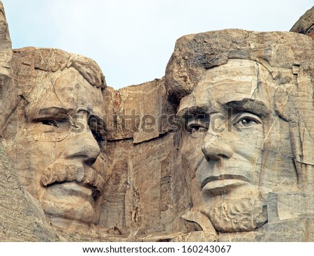 Sculpted images of Presidents Theodore Roosevelt, and Abraham Lincoln at the Mt. Rushmore National Memorial, Keystone, South Dakota - stock photo