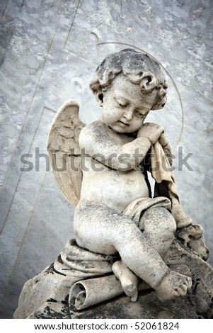 Sculpture at a Cemetery - stock photo