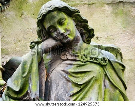 Sculpture at a old Prague cemetery - stock photo
