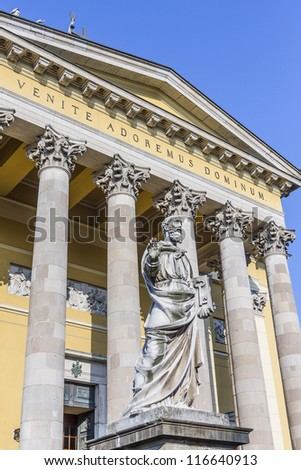 Sculpture at Basilica. The Cathedral or basilica of Eger - this is the third largest Catholic Church in Hungary. It was built between 1831 - 1837 in classicist designs by Joseph Hild. - stock photo