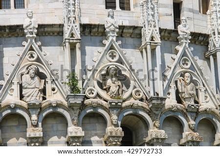 Sculpture compositions of St. John Baptistery (Battistero di San Giovanni) in Pisa, Italy - stock photo