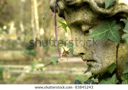Sculpture Detail in Graveyard. - stock photo