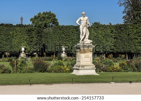Sculpture in Jardin des Tuileries (Tuileries garden) - favorite spot for rest of tourists and Parisians. Garden was created by Catherine de Medici in 1564. Paris, France. - stock photo