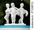 Sculpture in park. Children round dance. - stock photo