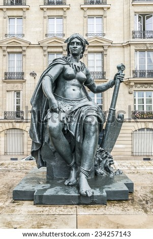 Sculpture near the entrance to D'Orsay Museum. D'Orsay - a museum on left bank of Seine, it is housed in former Gare d'Orsay. D'Orsay holds mainly French art dating from 1848 to 1915. - stock photo