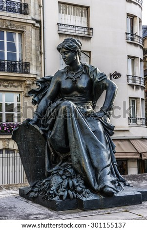 Sculpture near the entrance to D'Orsay Museum. D'Orsay - a museum on left bank of Seine, it is housed in former Gare d'Orsay. D'Orsay holds mainly French art dating from 1848 to 1915. Paris, France. - stock photo