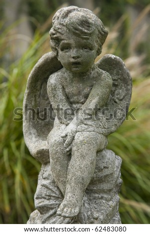 Sculpture of a cherub in Georgetown cemetery, in Washington DC. - stock photo