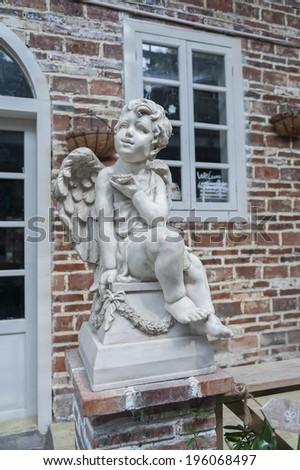 Sculpture of angel in garden - stock photo