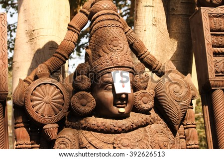 Sculpture of Balaji created through woodern carving - stock photo