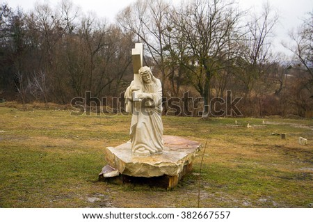 Sculpture of Jesus Christ carrying the cross in the monastery Condrita Moldova - stock photo