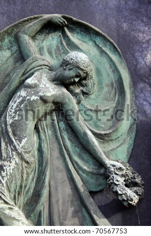 Sculpture of the young Woman from the old Prague Cemetery - stock photo