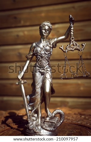 sculpture of themis, femida or justice goddess on wood lining background - stock photo
